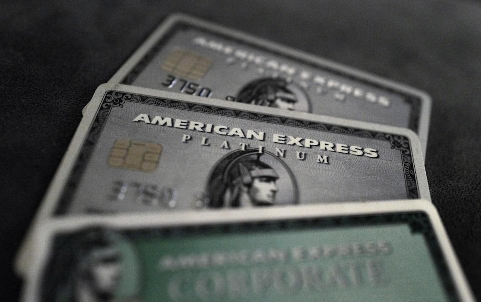 Credit cards of American Express are photographed in this illustration picture in this March 17, 2016, file photo. REUTERS/Kai Pfaffenbach/Illustration/Files  GLOBAL BUSINESS WEEK AHEAD PACKAGE - SEARCH 'BUSINESS WEEK AHEAD APRIL 18'  FOR ALL IMAGES
