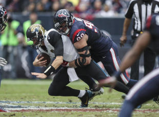 Jaguars QB Chad Henne is sacked by J.J. Watt last season. (USA TODAY Sports)