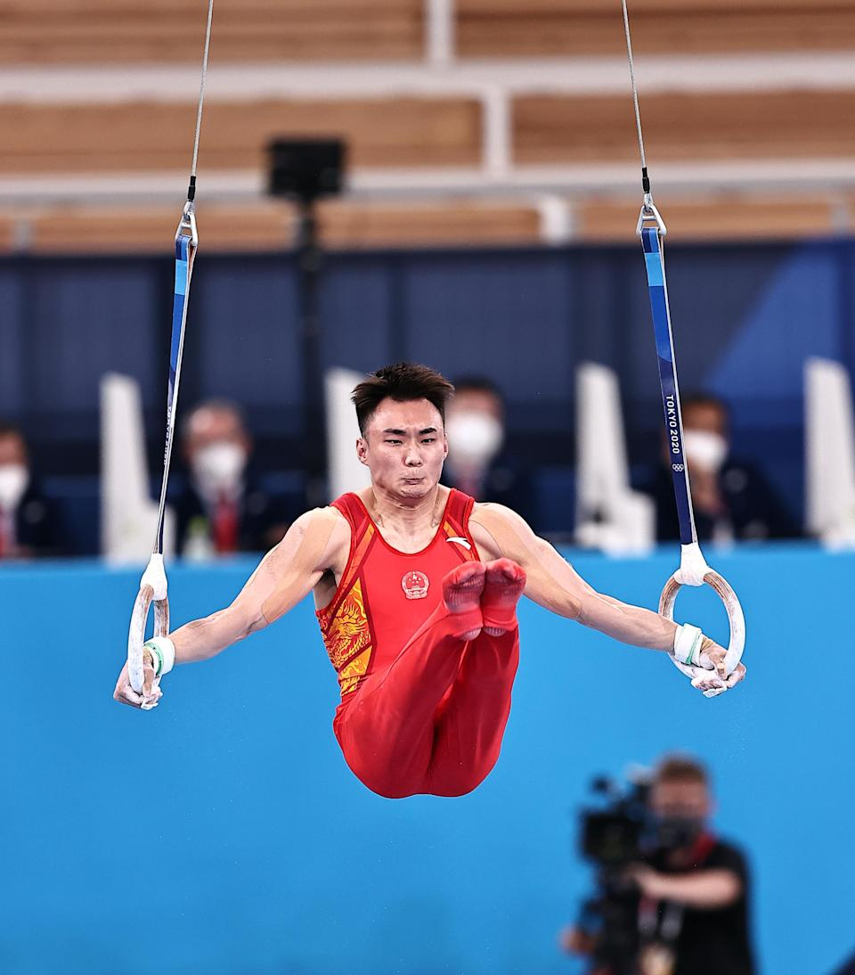 <p>TOKYO, JAPAN - JULY 28: Sun Wei of Team China competes on the rings during the Men's All-Around Final on day five of the Tokyo 2020 Olympic Games at Ariake Gymnastics Centre on July 28, 2021 in Tokyo, Japan. (Photo by Wang Xianmin/CHINASPORTS/VCG via Getty Images)</p>