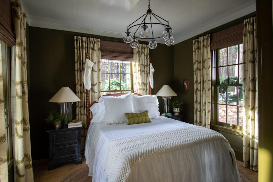 <p>A few festive touches like stockings hanging from the bedposts prep the guest room for visitors. </p>