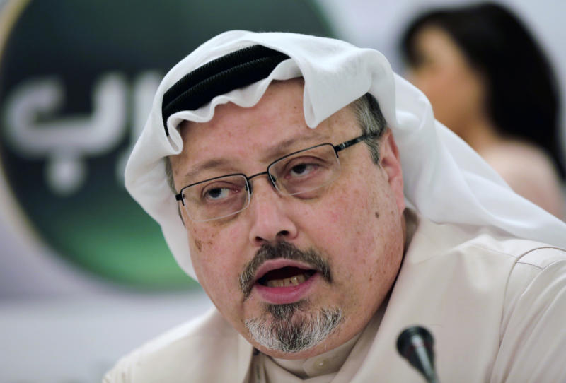 """FILE - In this Dec. 15, 2014 file photo, Saudi journalist Jamal Khashoggi speaks during a press conference in Manama, Bahrain.  United Nations experts Wednesday, Jan. 22, 2020 called for an """"immediate investigation"""" by the United States and others into information they received that suggests that Jeff Bezos' phone was hacked after receiving a file sent from Saudi Crown Prince Mohammed bin Salman's WhatsApp account. At a time when Saudi Arabia was supposedly investigating the killing of Saudi critic and Washington Post columnist Jamal Khashoggi and prosecuting those it deemed responsible, """"it was clandestinely waging a massive online campaign against Mr. Bezos and Amazon targeting him principally as the owner of The Washington Post,"""" the experts said in their statement.  (AP Photo/Hasan Jamali, File)"""