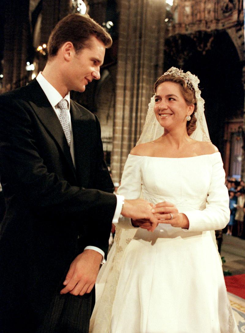 Spanish Infanta Cristina and her husband Inaki Urdangarin exchange wedding rings during their wedding at Barcelona's cathedral on October 4. Princess Cristina married Olympic handball star Urdangarin inside a majestic Gothic cathedral filled with royalty from around the world.