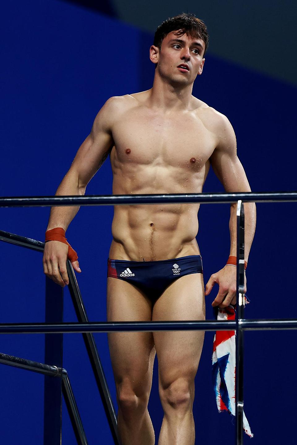 Tom Daley of Team Great Britain during aquatics training at the Tokyo Aquatics Centre ahead of the Tokyo 2020 Olympic Games - Credit: Clive Rose/Getty Images