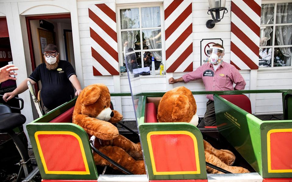 Teddy bears sit on roller coaster at theme park - REUTERS