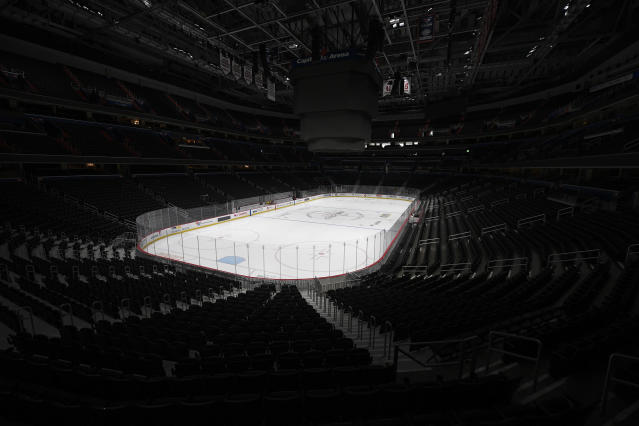The Capital One Arena, home of the Washington Capitals NHL hockey club, sits empty Thursday, March 12, 2020, in Washington. The NHL is following the NBA's lead and suspending its season amid the coronavirus outbreak, the league announced Thursday. (AP Photo/Nick Wass)