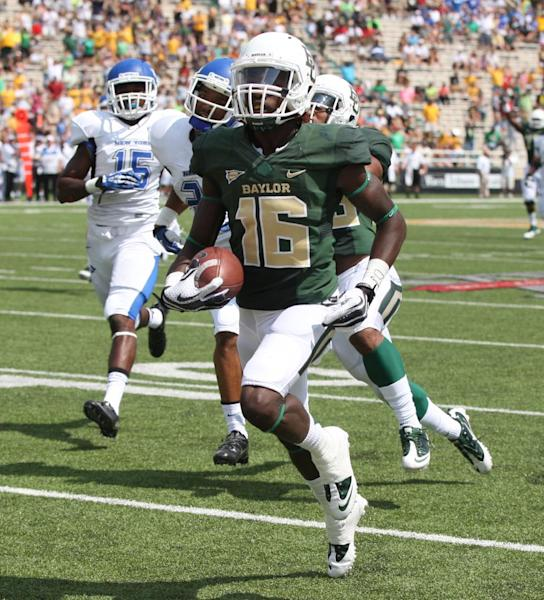 Baylor wide receiver Tevin Reese (16) scores past Buffalo defensive back Derek Brim (15), left, in the first half of a NCAA college football game, Saturday, Sept., 7, 2013, in Waco, Texas. (AP Photo/Waco Tribune Herald, Rod Aydelotte)