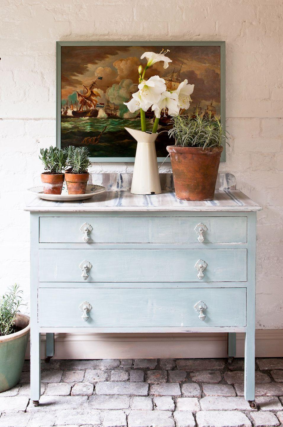 <p>The light blue Chalk Paint® gives this dresser a nice cheery look and the stripes on the surface drive home that French Country feel.</p>
