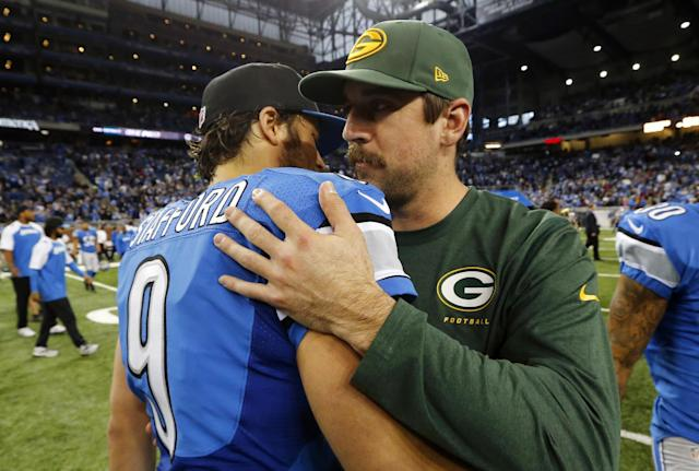 Detroit Lions quarterback Matthew Stafford (9) hugs Green Bay Packers quarterback Aaron Rodgers after an NFL football game at Ford Field in Detroit, Thursday, Nov. 28, 2013. The Lions won 40-10. (AP Photo/Paul Sancya)