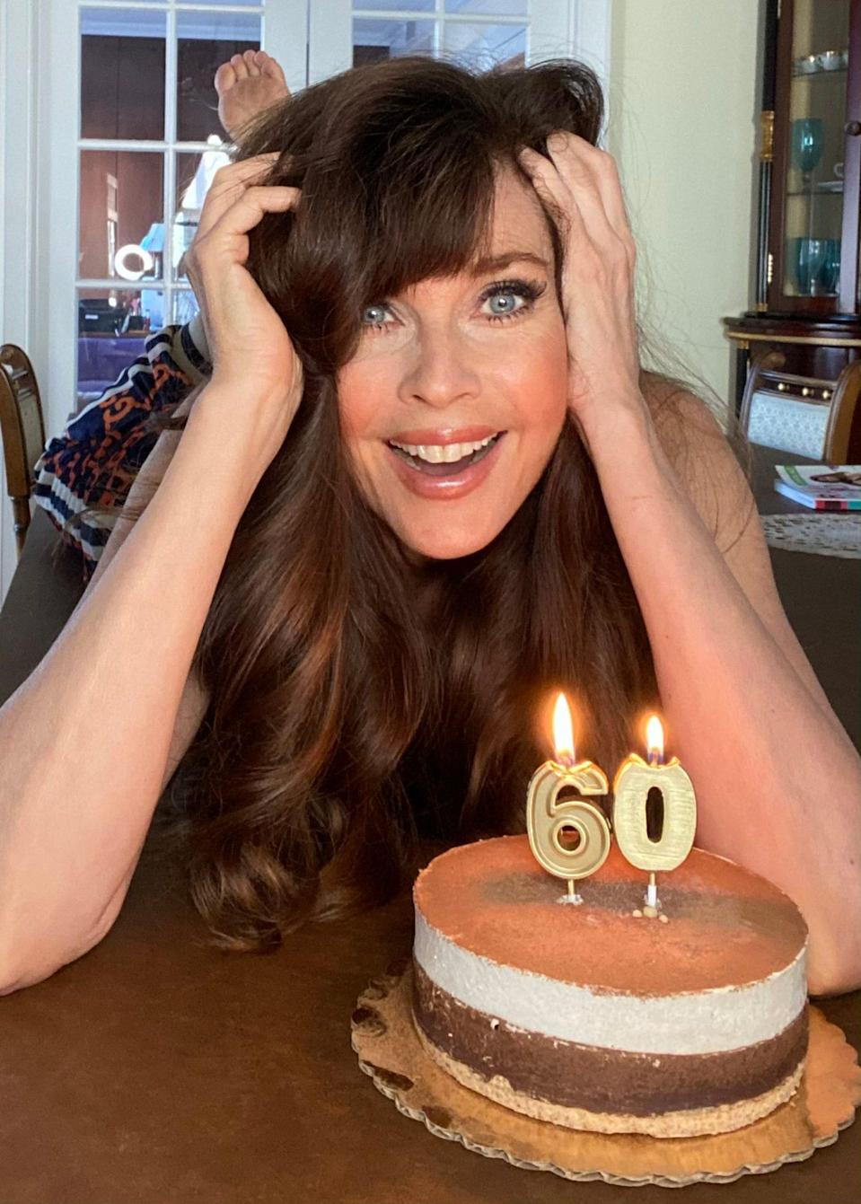 <p>Model Carol Alt celebrates her big 6-0 at home with a brightly lit cake on Tuesday.</p>