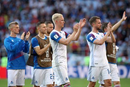 Soccer Football - World Cup - Group D - Argentina vs Iceland - Spartak Stadium, Moscow, Russia - June 16, 2018 Iceland's Hordur Bjorgvin Magnusson, Kari Arnason and team mates applaud the fans at the end of the match REUTERS/Albert Gea