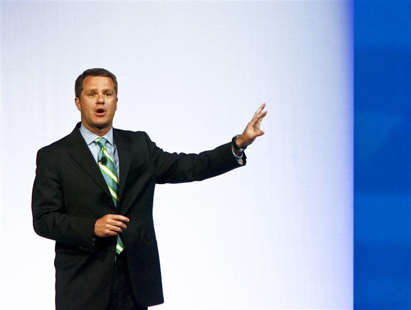 Doug McMillon, President and CEO, Wal-Mart Stores Inc. International, speaks to shareholders during Wal-Mart Stores Inc's annual general meeting in Fayetteville in this file photo