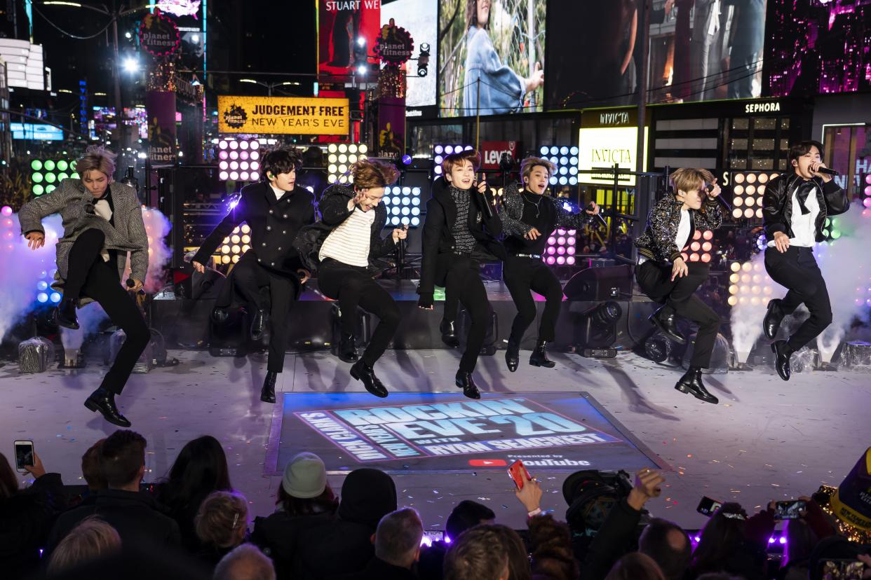 FILE - Korean pop band BTS performs at the Times Square New Year's Eve celebration in New York on Dec. 31, 2019.
