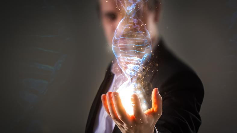 A man holding a piece of DNA in his hand.