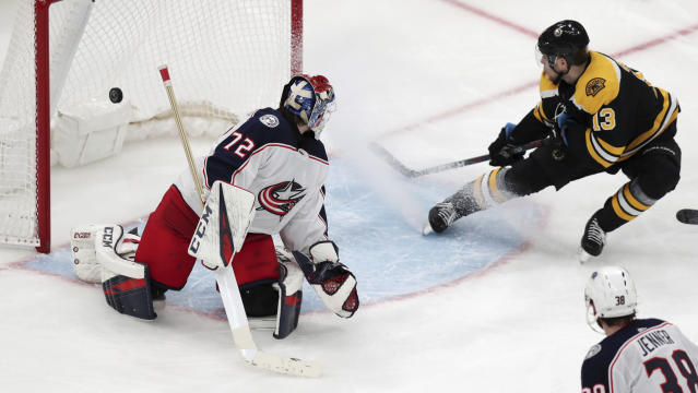 Boston Bruins center Charlie Coyle (13) beats Columbus Blue Jackets goaltender Sergei Bobrovsky (72) for the game-winning goal during overtime of Game 1 of an NHL hockey second-round playoff series, Thursday, April 25, 2019, in Boston. The Bruins won 3-2. (AP Photo/Charles Krupa)