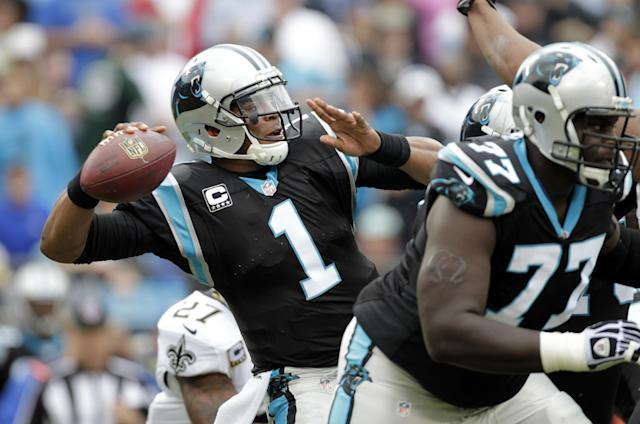 Carolina Panthers' Cam Newton (1) looks to pass against the New Orleans Saints in the first half of an NFL football game in Charlotte, N.C., Sunday, Dec. 22, 2013. (AP Photo/Bob Leverone)