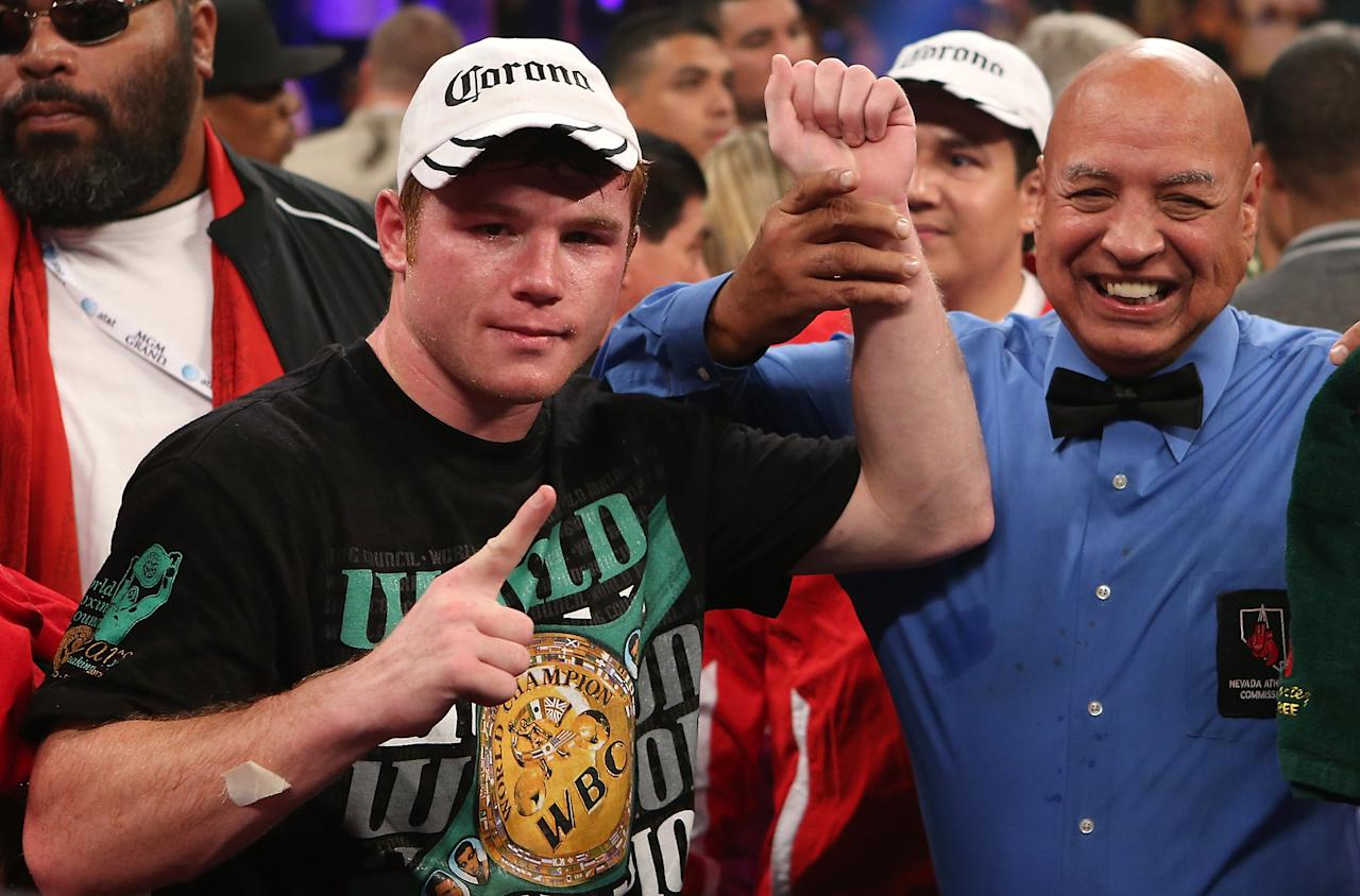 LAS VEGAS, NV - SEPTEMBER 15:  Canelo Alvarez (L) reacts after knocking out Josesito Lopez during their WBC super  welterweight title fight at MGM Grand Garden Arena on September 15, 2012 in Las Vegas, Nevada. (Photo by Josh Hedges/Getty Images)