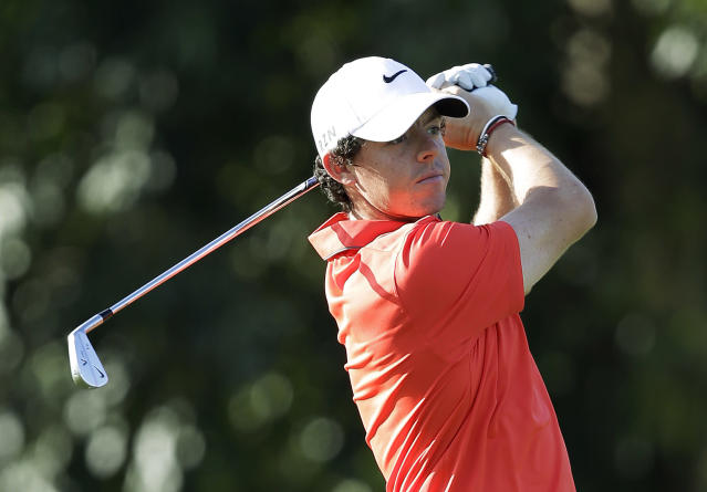 \Rory McIlroy, of Northern Ireland, watches his shot on the first hole during a practice round of the Cadillac Championship golf tournament, Wednesday, March 5, 2014, in Doral, Fla. (AP Photo/Wilfredo Lee)