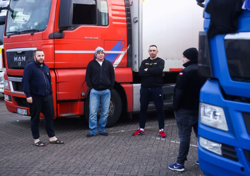 Lorry drivers from Poland speak with each other at Ashford International Truck Stop