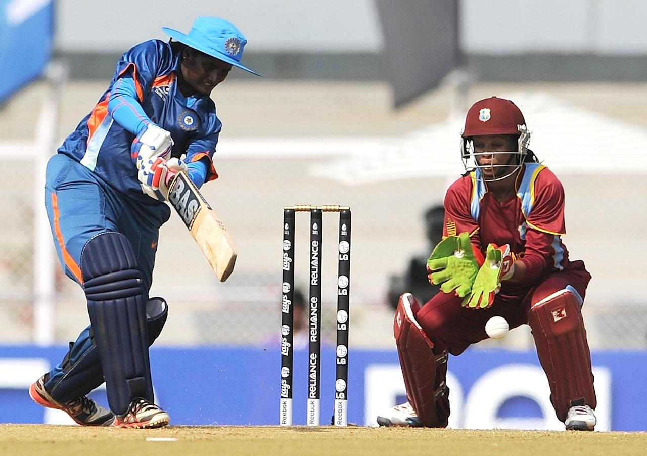 Indian cricketer Thirush Kamini (L) plays a shot as West Indian cricketer Merissa Aguelleria looks on during the inugural match of the ICC Women's World Cup 2013 between India and West Indies at the Cricket Club of India's Brabourne stadium in Mumbai on January 31, 2013. Teams from Australia, England, New Zealand, Pakistan, South Africa, Sri Lanka, West Indies join hosts India for the global event which is being played from 31 January to 17 February.  The women's World Cup opened in Mumbai with the cricketers hoping to put aside memories of the unsavoury build-up and gain their due recognition in a country where the men's game reigns supreme. AFP PHOTO/ Indranil MUKHERJEE        (Photo credit should read INDRANIL MUKHERJEE/AFP/Getty Images)