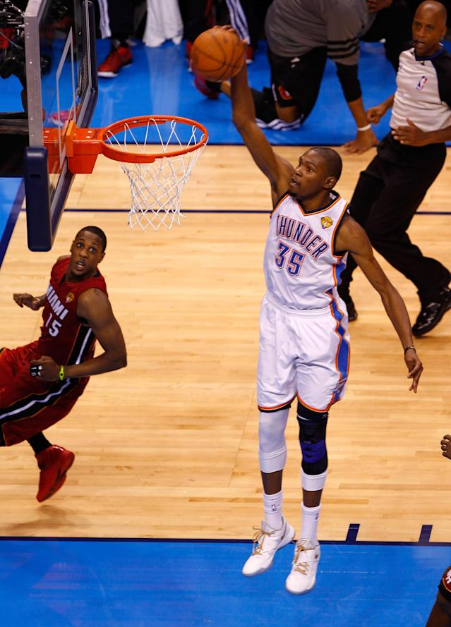 OKLAHOMA CITY, OK - JUNE 12: Kevin Durant #35 of the Oklahoma City Thunder dunks the ball in the fourth quarter against the Miami Heat in Game One of the 2012 NBA Finals at Chesapeake Energy Arena on June 12, 2012 in Oklahoma City, Oklahoma. NOTE TO USER: User expressly acknowledges and agrees that, by downloading and or using this photograph, User is consenting to the terms and conditions of the Getty Images License Agreement. (Photo by Mike Ehrmann/Getty Images)