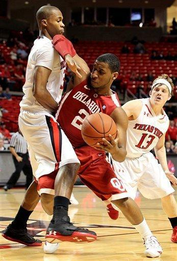 Oklahoma's Steven Pledger, center, works under pressure from Texas Tech's Jaye Crockett (30) and Luke Adams(13) during their NCAA college basketball game in Lubbock, Texas, Saturday, Feb. 11, 2012. (AP Photo/Lubbock Avalanche-Journal, Zach Long) ALL LOCAL TV OUT
