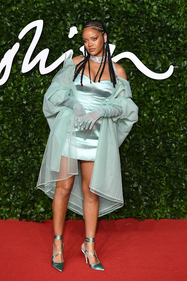 """<p>Wearing <a href=""""https://www.popsugar.com/fashion/rihanna-green-fenty-outfit-british-fashion-awards-2019-46966616"""" class=""""ga-track"""" data-ga-category=""""Related"""" data-ga-label=""""https://www.popsugar.com/fashion/rihanna-green-fenty-outfit-british-fashion-awards-2019-46966616"""" data-ga-action=""""In-Line Links"""">a mint green silk-satin Fenty minidress</a> with matching organza sleeves and trench coat.</p>"""