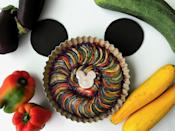 "<p>If you've ever wondered just what it takes to create the notorious roasted vegetable dish ratatouille, look no further than ""Disney's Ratatouille Recipe"" from <a href=""https://www.familycookbookproject.com/recipe/3520887/disneys-ratatouille.html"" class=""link rapid-noclick-resp"" rel=""nofollow noopener"" target=""_blank"" data-ylk=""slk:The Family Cookbook Project""><strong>The Family Cookbook Project</strong></a>. A Disneyland original recipe published in the <strong>Disneyland Resort Inspire Cookbook</strong>, this seemingly intricate dish comes together easier than one would think, stacking thinly sliced zucchini, eggplant, and bell pepper and roasting them to perfection.</p> <p><strong>Get the recipe</strong>: <a href=""https://www.popsugar.com/food/disney-ratatouille-recipe-47806610"" class=""link rapid-noclick-resp"" rel=""nofollow noopener"" target=""_blank"" data-ylk=""slk:Disney's ratatouille"">Disney's ratatouille</a></p>"