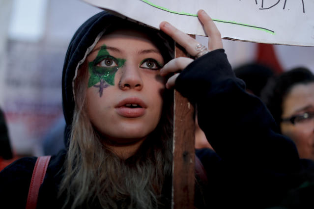<p>A demonstrator in support of decriminalizing abortion watches live images of lawmakers debating the issue, outside Congress in Buenos Aires, Argentina, Wednesday, Aug. 8, 2018. Following months of increasingly tense debate, lawmakers are meeting on Wednesday ahead of a vote on a bill that would decriminalize abortions up to the first 14 weeks of pregnancy. (AP Photo/Natacha Pisarenko) </p>