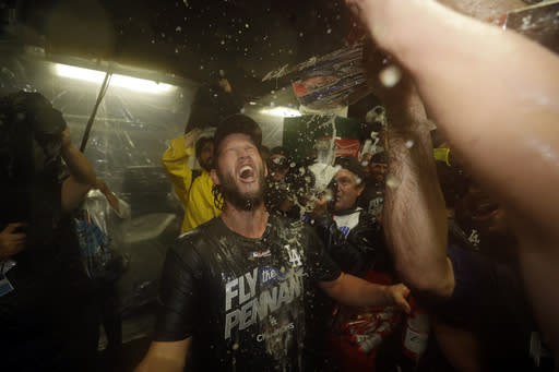 Clayton Kershaw and his teammates celebrate after Game 5 of the NLCS. (AP)