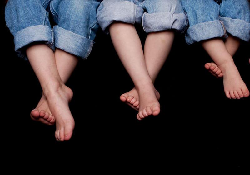 Barefoot kids with rolled-up jeans.