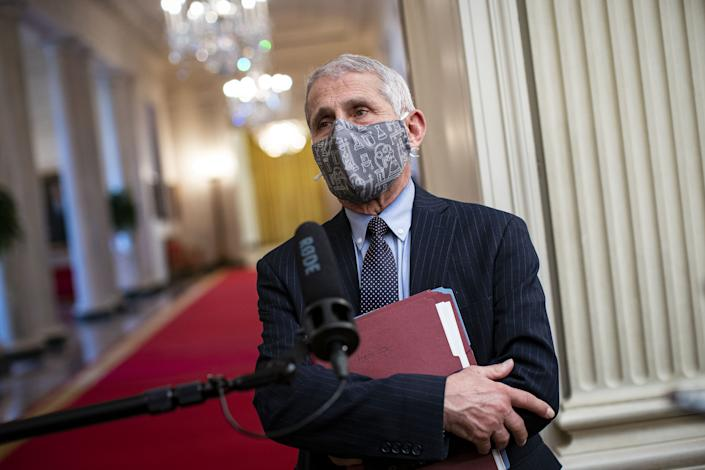 Anthony Fauci, director of the National Institute of Allergy and Infectious Diseases, wears a protective mask while speaking to members of the media before an event on the Biden administration's Covid-19 response in the State Dining Room of the White House in Washington, D.C., U.S., on Thursday, Jan. 21, 2021. (Al Drago/Bloomberg via Getty Images)