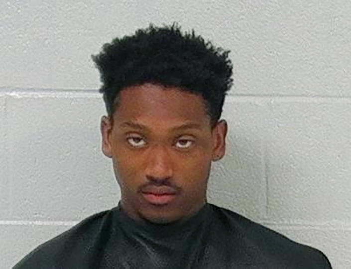 This undated booking photo provided by the Carroll County, Ga., Sheriff's Office shows Aaron Shelton. Three Georgia police officers were shot and wounded as they pursued brothers Aaron Jajuan Shelton and Pier Alexander Shelton, from Alabama, in a high-speed chase that ended early Monday, April 12, 2021, with Pier shot and killed and Aaron in custody, authorities said. (Carroll County Sheriff's Office via AP)