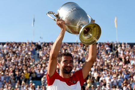 Tennis - ATP 500 - Fever-Tree Championships - The Queen's Club, London, Britain - June 24, 2018   Croatia's Marin Cilic celebrates with the trophy after winning the final against Serbia's Novak Djokovic   Action Images via Reuters/Tony O'Brien     TPX IMAGES OF THE DAY