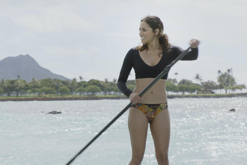 <p>Tani Rey (Meaghan Rath) is enjoying some paddleboarding. </p>