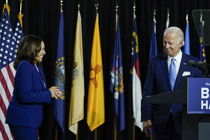 Presumptive Democratic presidential nominee Joe Biden invites his new running mate, Sen. Kamala Harris, to the stage Wednesday in Wilmington, Delaware, to deliver her first remarks as a vice presidential candidate.