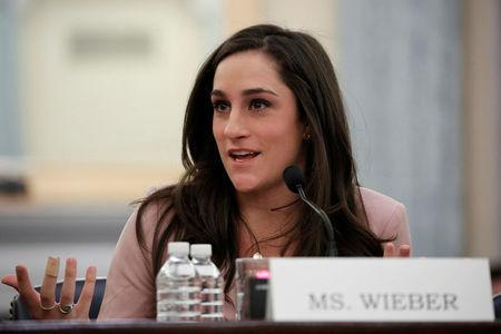 "Olympic gymnast Jordyn Wieber testifies at a Senate Commerce subcommittee hearing entitled ""Olympic Abuse: The Role of National Governing Bodies in Protecting Our Athletes"" on Capitol Hill in Washington, U.S., April 18, 2018. REUTERS/Aaron P. Bernstein"