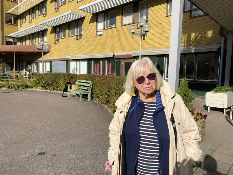 Ingrid Bolander poses for a photo on her way to visit husband admitted to the care facility, in Gothenburg