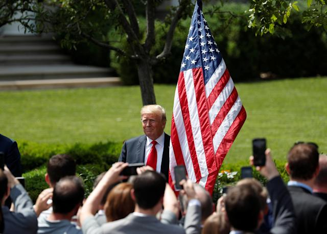 """U.S. President Donald Trump departs his """"celebration of America"""" event on the South Lawn of the White House in Washington, U.S., June 5, 2018. The event was arranged after Trump canceled the planned visit of the Super Bowl champion Philadelphia Eagles to the White House. REUTERS/Kevin Lamarque"""