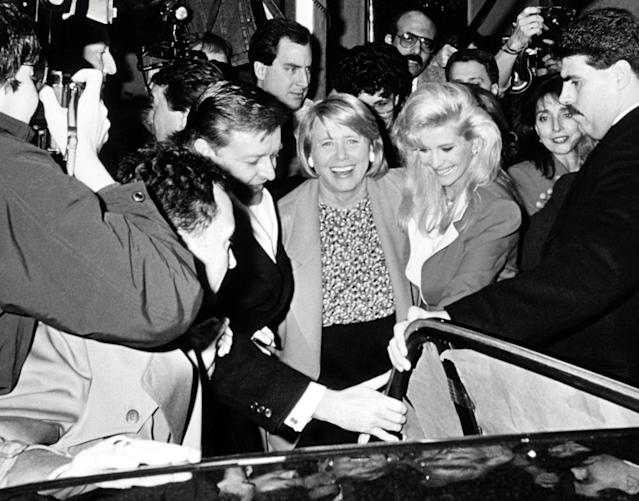 Smith took sides — Ivana's — in the Trump's 1990 divorce. Here, they were mobbed by press on the way to a birthday lunch for Ivana just after the divorce was announced. (Photo: Getty Images)