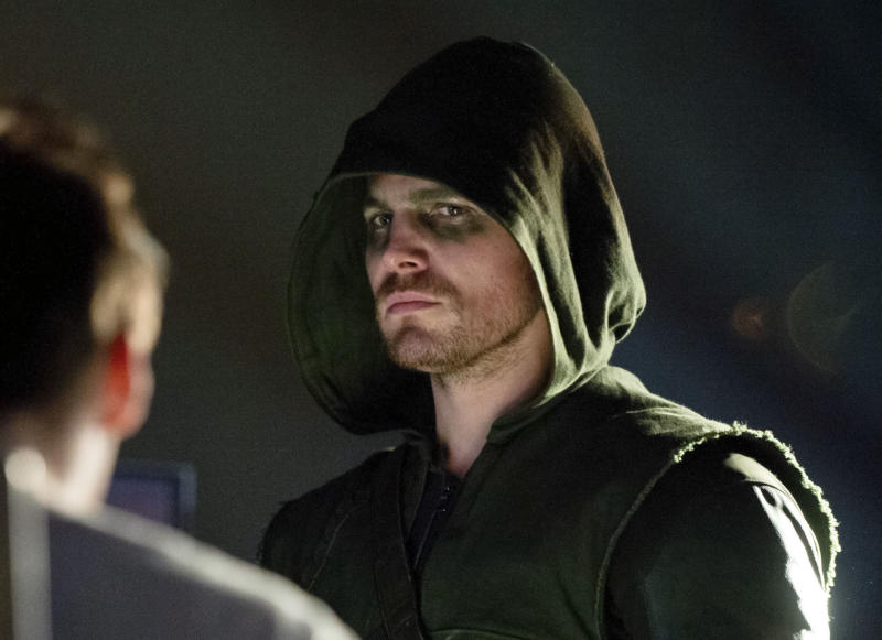 """This publicity image released by The CW shows Stephen Amell as Oliver Queen/Arrow in a scene from """"Arrow."""" (AP Photo/The CW, Cate Cameron)"""