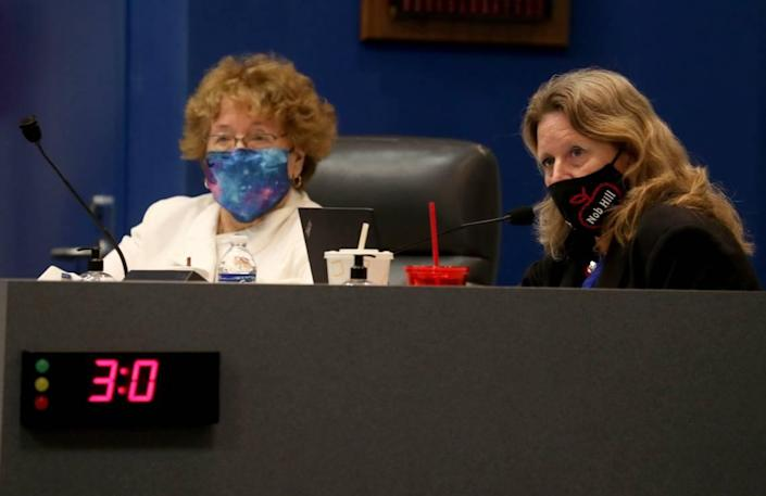 Broward School Board members Ann Murray, left, and Debra Hixon attend a meeting where the Broward School Board approved, in a 5-4 vote, a $754,900 exit package for Superintendent Robert Runcie on Tuesday, May 11, 2021, in Fort Lauderdale. On April 15, Runcie was indicted by a grand jury on a perjury charge. His last day is scheduled to be Aug. 10, although he is expected to stop serving as superintendent once an interim replacement is named.