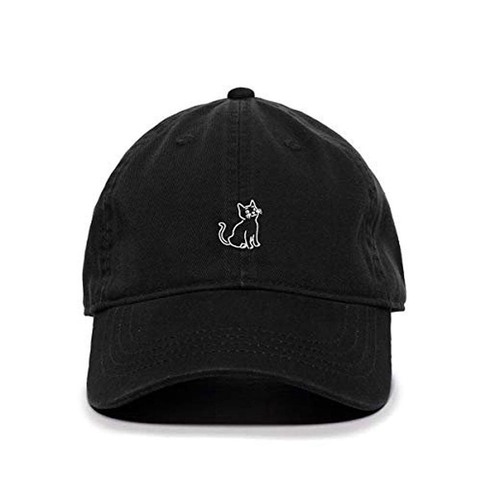 """<p>Now, cat dads can carry a little feline with them wherever they go. </p> <p><strong>Buy it!</strong> Embroidered Cat Baseball Cap, $16.99; <a href=""""https://www.awin1.com/cread.php?awinmid=6220&awinaffid=272513&clickref=PEO10FathersDayGiftsforCatandDogDadsWhoAreObsessedwithTheirPetskbender1271PetGal12773282202106I&p=https%3A%2F%2Fwww.etsy.com%2Flisting%2F795659801%2Fcat-baseball-cap-embroidered-cotton"""" rel=""""sponsored noopener"""" target=""""_blank"""" data-ylk=""""slk:Etsy.com"""" class=""""link rapid-noclick-resp"""">Etsy.com</a></p>"""