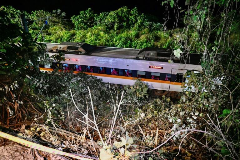 Rescuers used metal cutters to get to some carriages