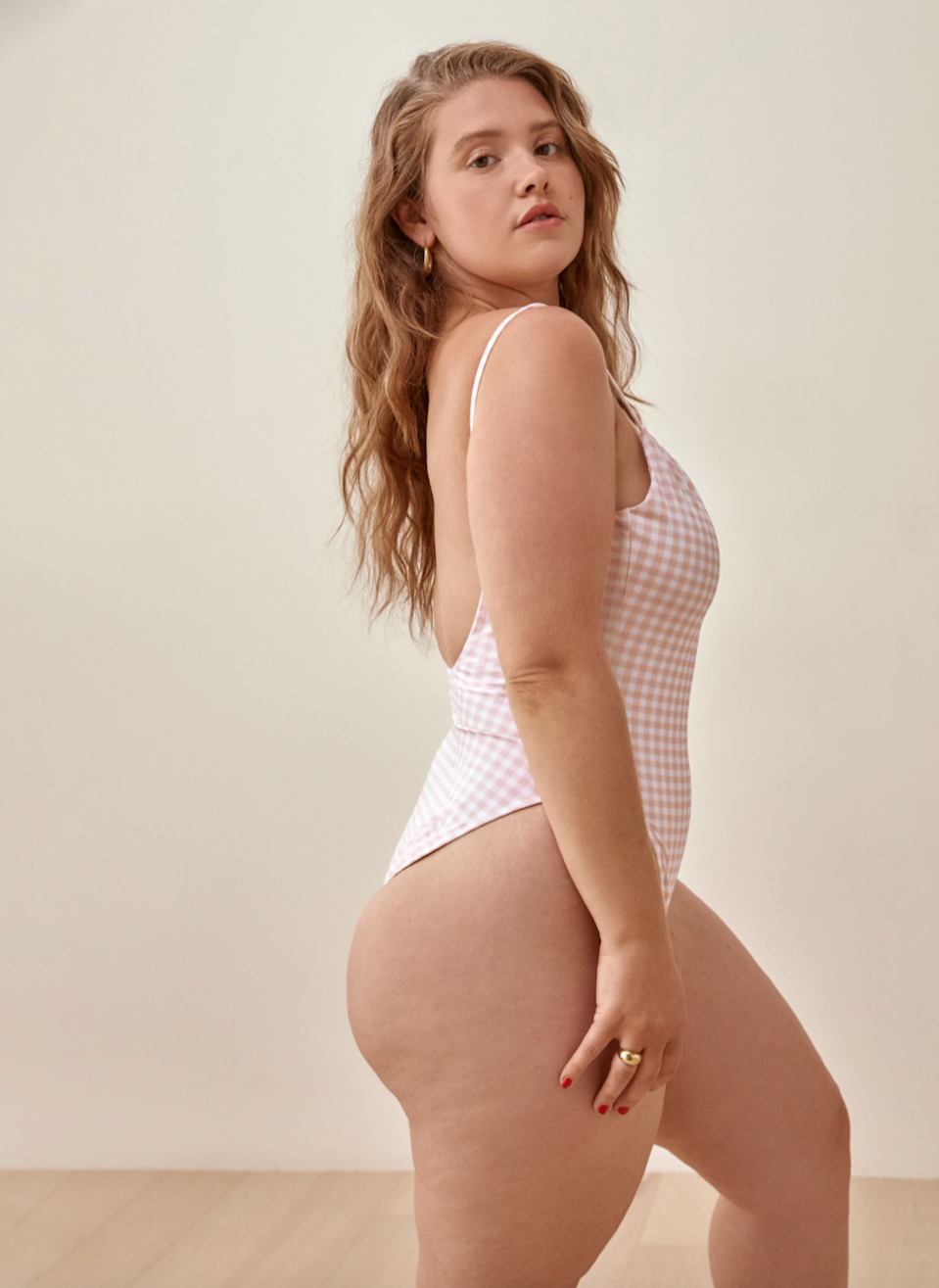 """<br><br><strong>Reformation</strong> Wave Scoop Back One Piece, $, available at <a href=""""https://go.skimresources.com/?id=30283X879131&url=https%3A%2F%2Fwww.thereformation.com%2Fproducts%2Fwave-one-piece%3Fcolor%3DBlush%2BCheck"""" rel=""""nofollow noopener"""" target=""""_blank"""" data-ylk=""""slk:Reformation"""" class=""""link rapid-noclick-resp"""">Reformation</a>"""
