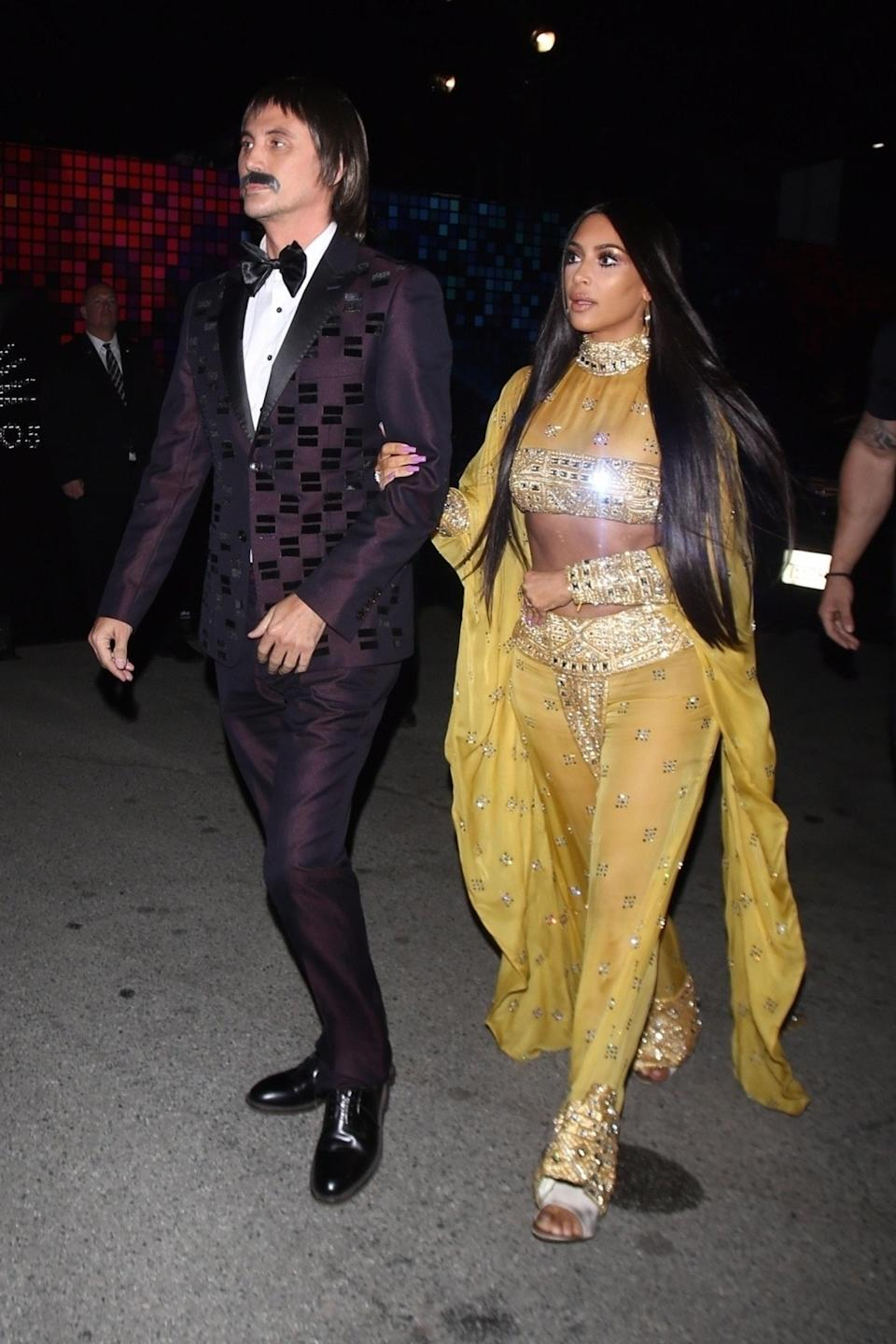 """<p>Jonathan Cheban is the Sonny to Kim's Cher. The BFFs dressed as the iconic duo for the Casamigos Annual Halloween Party, channeling the pair's 1973 Oscars look. The reality star's getup was Cher-approved. """"Woke up to see you are me 4 [Halloween],"""" Cher tweeted at Kardashian. """"You look BEAUTIFUL little Armenian sister."""" (Photo: Backgrid) </p>"""