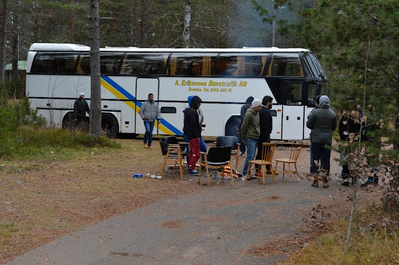 Migrants occupied a bus in Sweden in October, refusing to stay in an isolated village made up by wooden chalets located in dense woods, though eventually most of them accepted the facility (AFP Photo/Nisse Schmidt/TT)