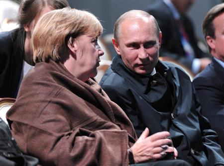 "Russian President Putin and German Chancellor Merkel talk as they watch a fragment from the ballet ""Ruslan and Lyudmila"" during the G20 Summit in Peterhof near St. Petersburg"