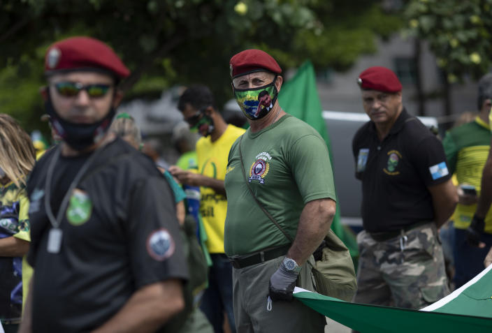 Supporters of Brazilian President Jair Bolsonaro, some dressed as military personnel, take part in a demonstration to show their support for him after leaders of all three branches of the armed forces jointly resigned following Bolsonaro's replacement of the defense minister, on Copacabana beach in Rio de Janeiro, Brazil, Wednesday, March 31, 2021. (AP Photo/Silvia Izquierdo)