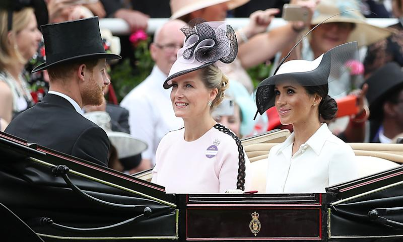 The Duke and Duchess of Sussex arrive alongside Sophie, Countess of Wessex.