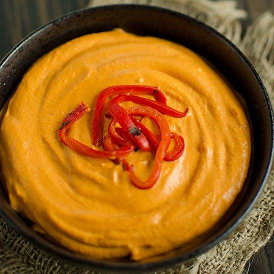 """<p>This brightly colored hummus has a slight sweetness and lots of rich flavor.</p><p><a href=""""https://www.foodandwine.com/recipes/roasted-red-pepper-hummus"""">GO TO RECIPE</a></p>"""